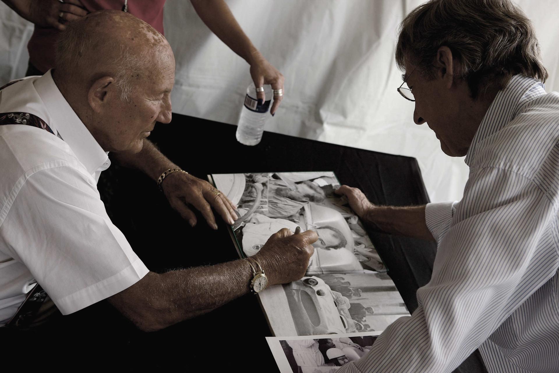 Sir Stirling Moss signs memorabilia.